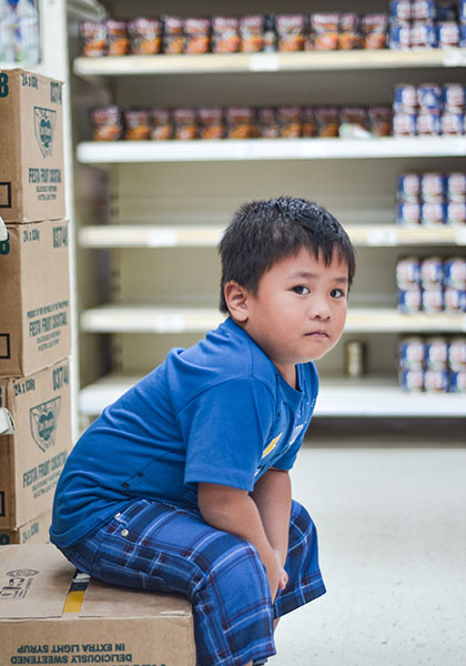 Boy seated in Food Bank